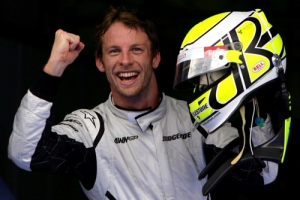 Jenson Button of Brawn GP celebrates taking pole position.